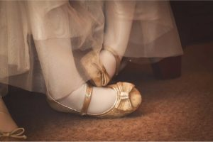 Safe and Sound Event Childcare - gold shoes on a young guest at a wedding